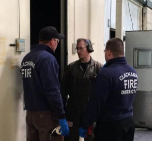 Mike briefs two fire fighters on what they're about to encounter in their scenario