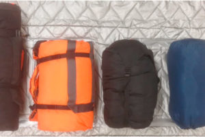 Co-TCCC guideline update hypothermia management showing a sleeping bag, HPMK, and other options